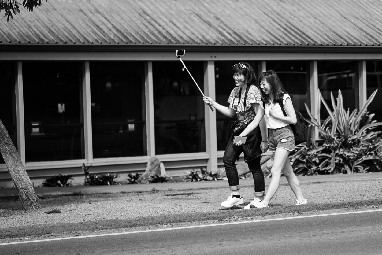 Tourists with selfie stick - Haleiwa, Oahu