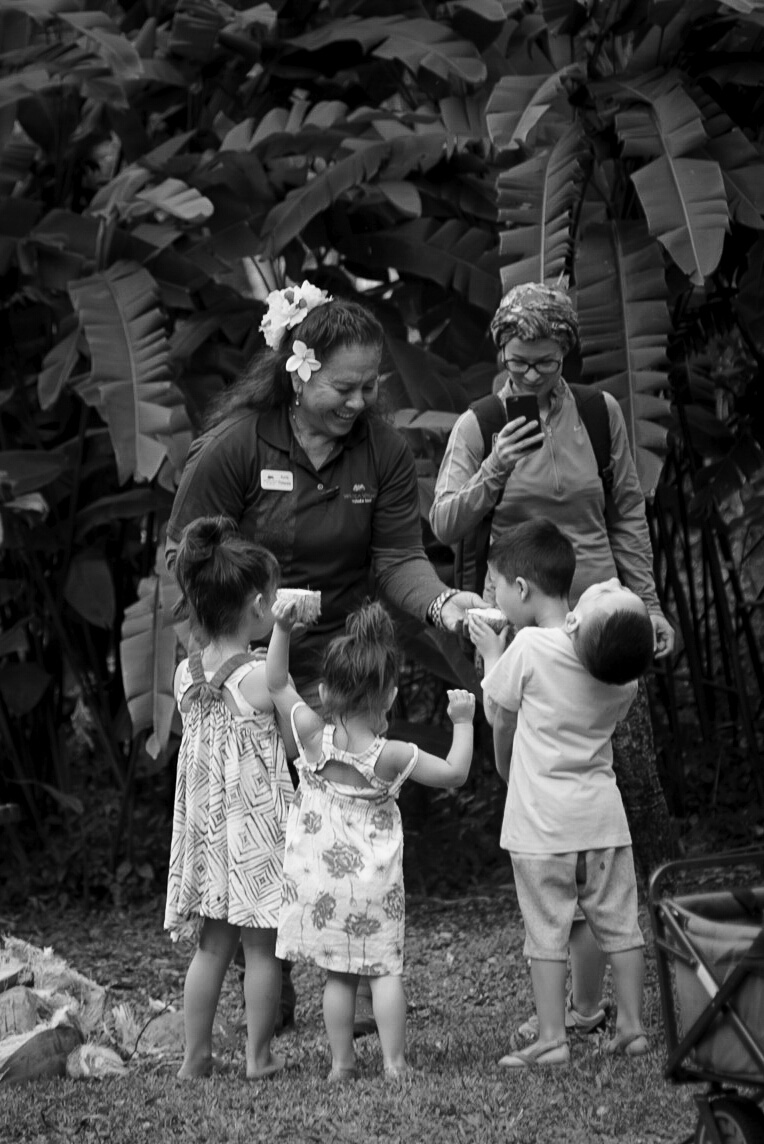 Kids trying coconut water - Waimea valley, Oahu