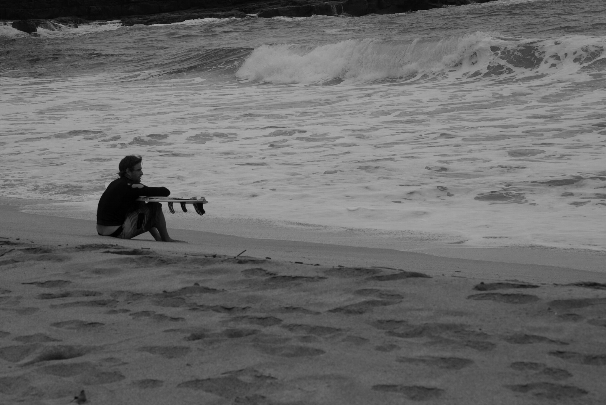 Surfer judging the waves - Lumaha'i beach, Kauai