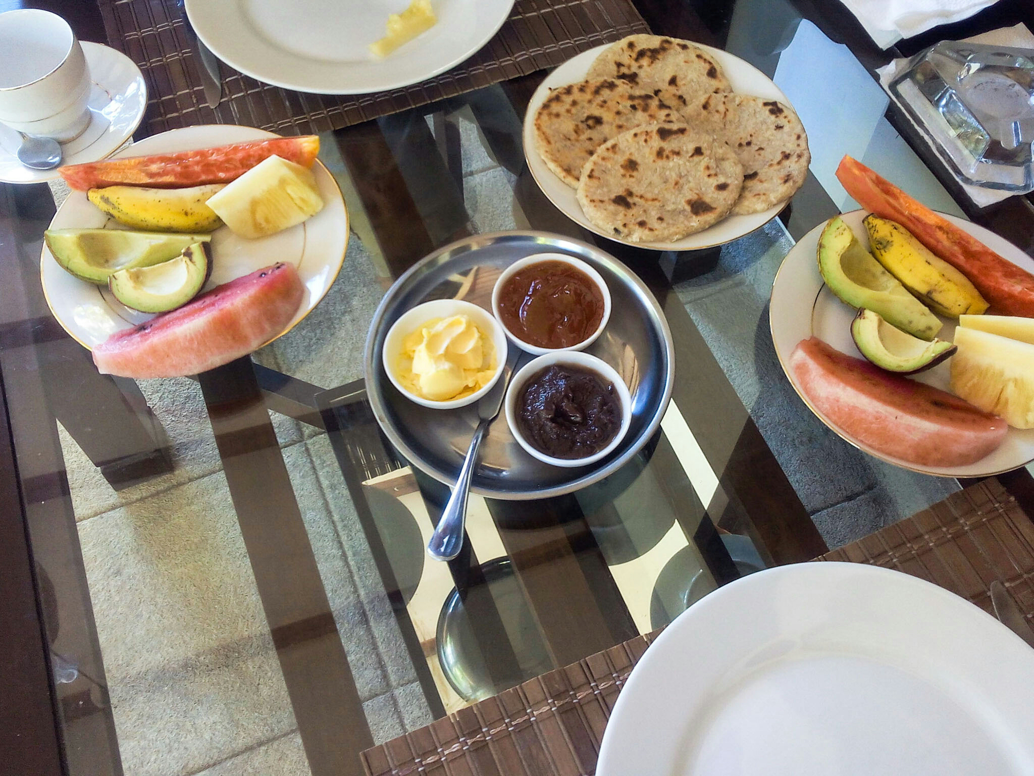 Sri Lankan breakfast: coconut rottis with fresh fruits and homemade jams